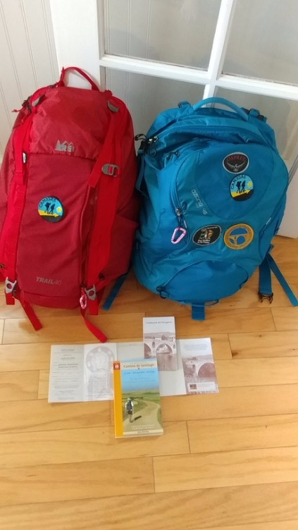 REI and OSPREY backpacks and Pilgrims Passports