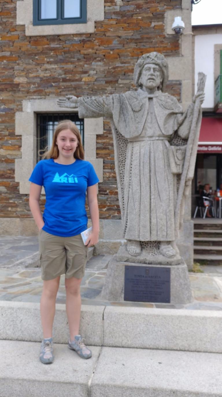 Elizabeth standing next to Pilgrim Statue